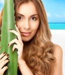 women face with aloe vera